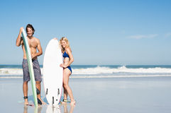 Surfer couple standing Royalty Free Stock Images
