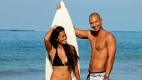 Surfer couple stock video footage