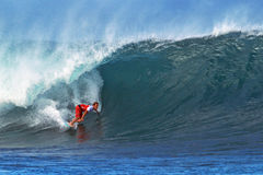 Surfer Damien Hobgood Surfing Pipeline in Hawaii Stock Image