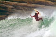 Surfer at dawn. Surfer riding the wave just after dawn Stock Photography