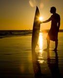 surfer de coucher du soleil Photos stock