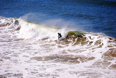 Surfer in der Tätigkeit Lizenzfreie Stockbilder
