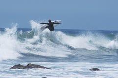 Surfer die Lucht krijgt stock foto