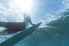 Surfer Duckdives Stock Images