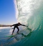 Surfer Ducking into Tube royalty free stock photography