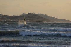 Surfer at dusk Stock Photo