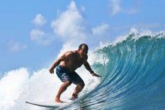 Surfer Egan Inoue surfing in Hawaii royalty free stock image