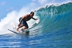 Surfer Egan Inoue surfing in Hawaii stock photo