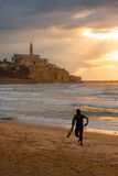 Surfer Emerging at Sunset - Old Jaffa, Israel - Mediterranean Royalty Free Stock Photos