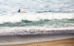Surfer enjoys the waves of the ocean. In Southern California in summer Stock Photography