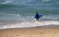 Surfer enjoys the waves of the ocean. In Southern California in summer Royalty Free Stock Photography