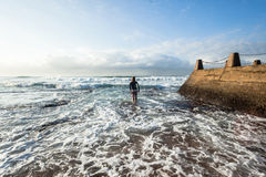 Surfer Entering Ocean Waves Royalty Free Stock Photos