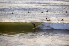 Surfer Entering Tube Wave, Water Sports, Sundown royalty free stock images