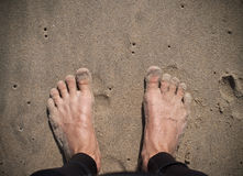 Surfer Feet on Sand Stock Photography