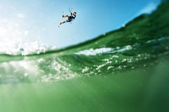 Surfer flying over the water Stock Photo