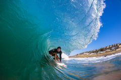 Surfer Rides Hollow Wave  Stock Photo