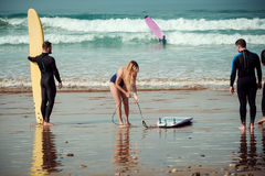 Surfer friends on a beach with a surfing boards.  Royalty Free Stock Photos
