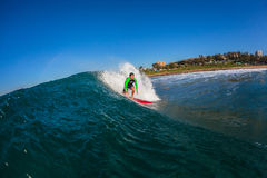 Surfer Fun Riding Blue Wave Stock Images