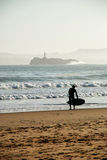 Surfer. Getting ready in the seashore Stock Photography