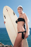 Surfer gil with surfboard under blue sky Stock Photography