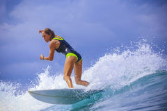 Surfer girl on Amazing Blue Wave Stock Photos