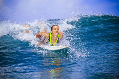 Surfer girl on Amazing Blue Wave Stock Images