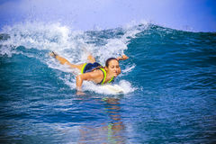 Surfer girl on Amazing Blue Wave Stock Photography