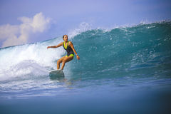 Surfer girl on Amazing Blue Wave Royalty Free Stock Image