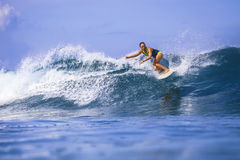 Surfer girl on Amazing Blue Wave Royalty Free Stock Photography