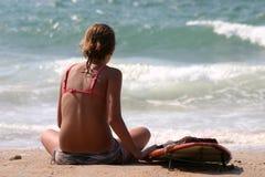 Surfer girl on the beach Stock Photos