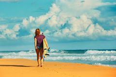 Surfer girl an the beach Stock Photography