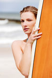 Surfer girl on the beach in bikini. Stock Image