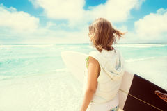 Surfer girl on the beach Royalty Free Stock Photo