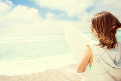 Surfer girl on the beach Stock Photos