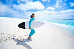 Surfer girl on the beach Royalty Free Stock Photography