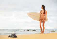 Surfer Girl on the Beach at Sunset Stock Photography