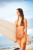 Surfer Girl on the Beach at Sunset Stock Image