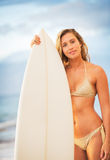 Surfer Girl on the Beach at Sunset Royalty Free Stock Photos
