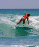 Surfer Girl Bethany Hamilton Surfing. Pro Surfer, Bethany Hamilton, surfing in Waikiki on the island of Oahu, Hawaii.  Bethany Hamilton lost her arm during a Stock Images