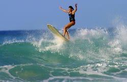 Surfer Girl Brooke Rudow in Hawaii. Pro Surfer, Brooke Rudow, surfing on a longboard in Waikiki on the island of Oahu, Hawaii Royalty Free Stock Photography