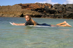 Surfer Girl Cecilia Enriquez in Hawaii. Professional surfer girl, Cecilia Enriquez, floats in the water on her surfboard Royalty Free Stock Photography