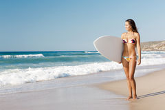 Surfer girl with her surfboard Royalty Free Stock Images