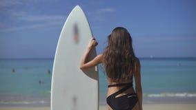 Surfer Girl Looking At Ocean