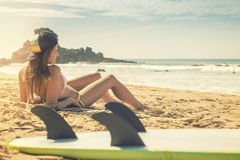 Surfer girl lying on the beach and watching to the ocean royalty free stock photos