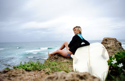 Surfer girl sitting Stock Photos