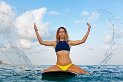 Surfer girl on surfboard have a fun before surfing Royalty Free Stock Photos