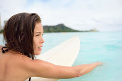 Surfer girl surfing paddeling on surfboard Royalty Free Stock Image