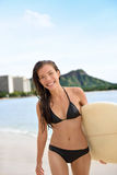 Surfer girl surfing walking with surfboard Waikiki Stock Photo