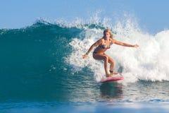 Surfer Girl. Surfer girl surfs a wave in Indian ocean Royalty Free Stock Images