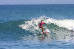Surfer girl on the wave. Indonesia Stock Images